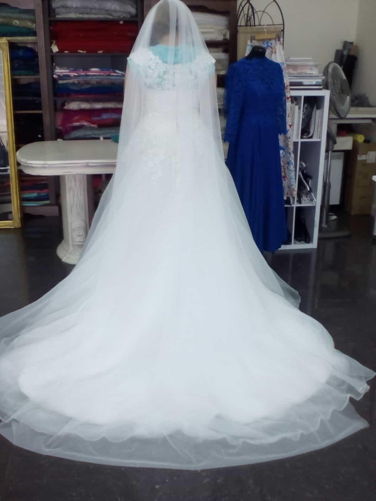 Vestido de novia elegante y exclusivo con un estilo adecuado a la novia.