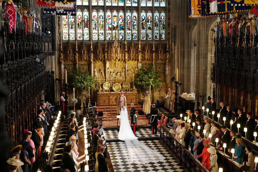 Prince Harry and Meghan Markle stand at the altar in St George's Chapel in Windsor Castle during their wedding service in Windsor, Britain, May 19, 2018. Owen Humphreys/Pool via REUTERS